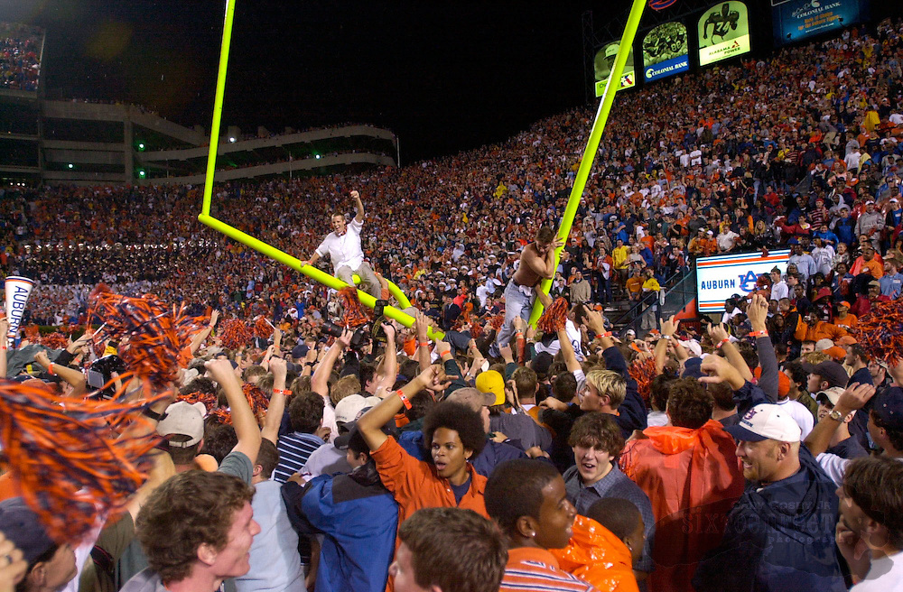 Photo by Gary Cosby Jr.  ..Auburn fans take down the goal posts after upsetting then number ranked Florida in a game in Jordan-Hare Stadium in Auburn during the 2001 season.