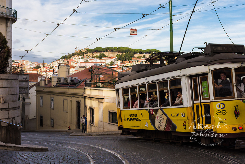 Tram (street car), with the Castle of San Jorge on the hill in the background, Lisbon, Portugal