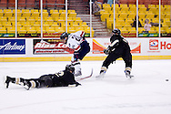 October 13, 2007 - Anchorage, Alaska: Jason Towsley (20) of the Robert Morris Colonials has his shot on goal deflected by a diving Wayne State player in the Colonials 4-1 victory over the Wayne State Warriors at the Nye Frontier Classic at the Sullivan Arena.