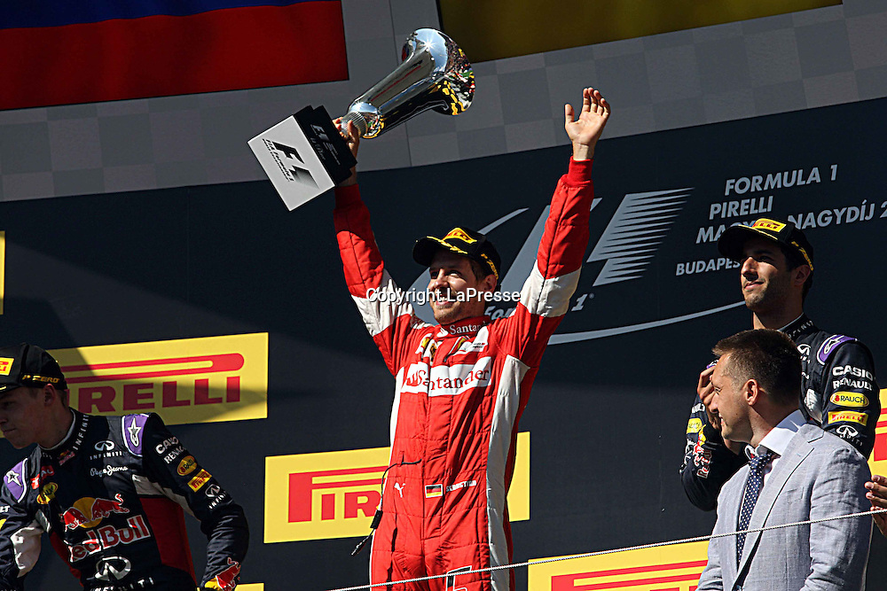 &copy; Photo4 / LaPresse<br /> 26/07/2015 Budapest, Hungary<br /> Sport <br /> Grand Prix Formula One Hungary 2015<br /> In the pic podium:<br /> 1st position Sebastian Vettel (GER) Scuderia Ferrari SF15-T<br /> 2nd position Daniil Kvyat (RUS) Red Bull Racing RB11 <br /> 3rd position Daniel Ricciardo (AUS) Red Bull Racing RB11