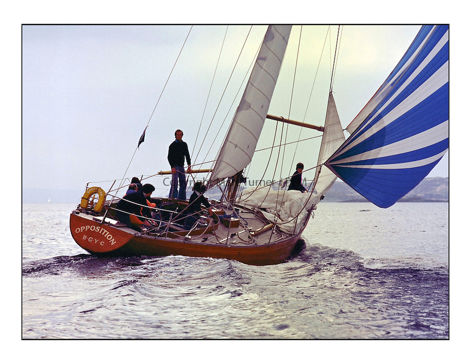 The Clyde Cruising Club's 1977 Tomatin Trophy the first Scottish Series held at Tarbert Loch Fyne.  An overnight race from Gourock to Campbeltown then on to Olympic Triangles in Loch Fyne. ..K3255 Opposition off wind with Dusty McKinnon standing