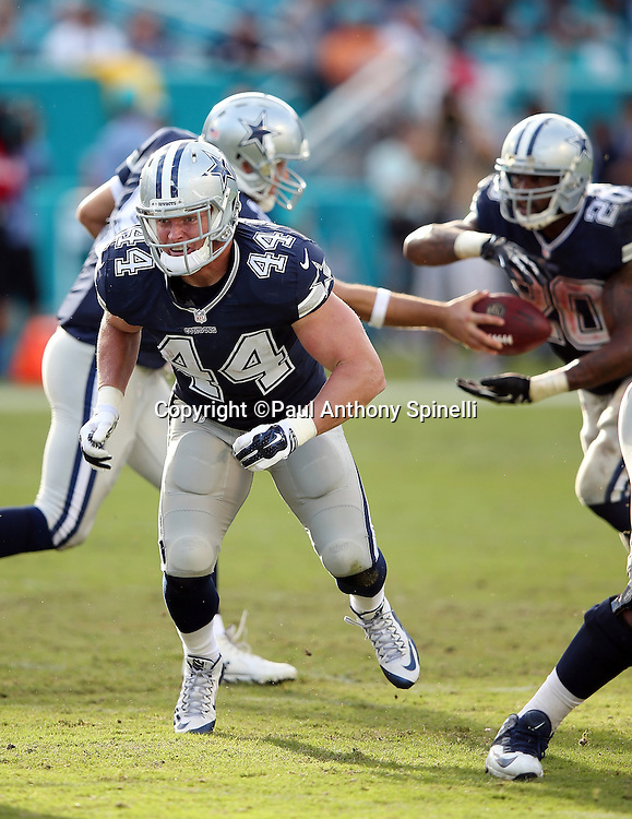 Dallas Cowboys fullback Tyler Clutts (44) lead blocks as Dallas Cowboys running back Darren McFadden (20) takes a handoff from Dallas Cowboys quarterback Tony Romo (9) during the 2015 week 11 regular season NFL football game against the Miami Dolphins on Sunday, Nov. 22, 2015 in Miami Gardens, Fla. The Cowboys won the game 24-14. (©Paul Anthony Spinelli)