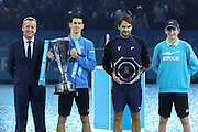 Novak Djokovic and Roger Federer with their trophies after the final of the ATP World Tour Finals between Roger Federer of Switzerland and Novak Djokovic at the O2 Arena, London, United Kingdom on 22 November 2015. Photo by Phil Duncan.