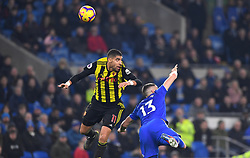 Watford's Adam Masina (left) and Cardiff City's Callum Paterson battle for the ball during the Premier League match at the Cardiff City Stadium.