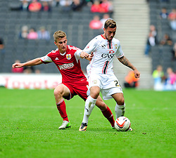 Bristol City's Joe Bryan jostles for the ball with Milton Keynes Dons' Samir Carruthers  - Photo mandatory by-line: Dougie Allward/JMP - Tel: Mobile: 07966 386802 24/08/2013 - SPORT - FOOTBALL - Stadium MK - Milton Keynes -  Milton Keynes Dons V Bristol City - Sky Bet League One