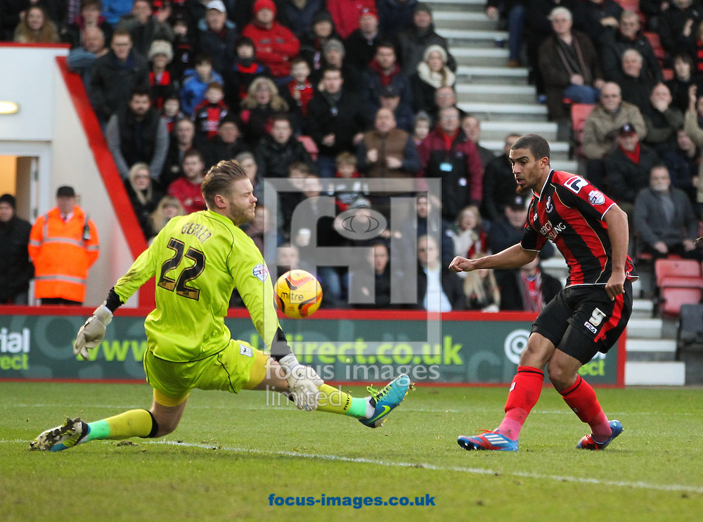 Picture by Tom Smith/Focus Images Ltd 07545141164<br /> 29/12/2013<br /> Lewis Grabban (right) of Bournemouth has his shot saved by Dean Gerken (left) of Ipswich Town during the Sky Bet Championship match at the Goldsands Stadium, Bournemouth.