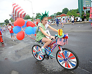 Danielle Craven, 11 rides her Liberty themed bike during the Lower Southampton Independence Day Parade Saturday July 4, 2015 in Feasterville, Pennsylvania. (Photo by William Thomas Cain)