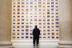 © Licensed to London News Pictures. 11/11/2019. London, UK. Turner Prize-winning artist and Oscar-winning filmmaker Steve McQueen views the photographs during the preview of his Year 3 exhibition at Tate Britain. An installation of over 3,000 class photographs lining the walls of Tate Britain's Duveen Galleries, depicting more than 70,000 Year 3 pupils from London's primary schools.The exhibition opens on 12 November until 3 May 2020. Photo credit: Dinendra Haria/LNP