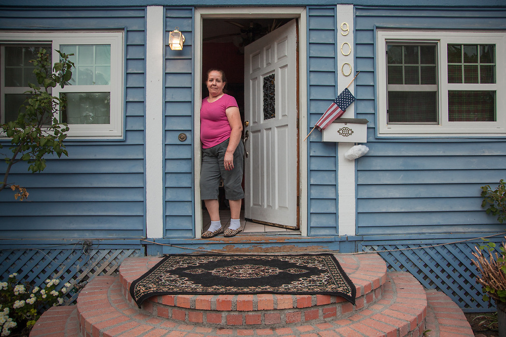 """Elvia Maldonado with her daughter, Cecilia, at their front door in Calistoga, California.  """"My mother moved here from Mexico15 years ago...she loves Calistoga because it is so quiet.  My mother has never learned to speak English.""""  -Cecilia Maldonado  cecimaldonado56@yahoo.com"""