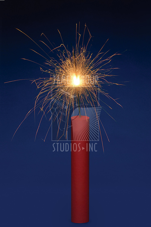 Stick of dynamite with a lit fuse on a blue background