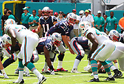 Sep 15, 2019; Miami Gardens, FL, USA;  New England Patriots quarterback Tom Brady (12) calls a play while Patriots wide receiver Julian Edelman (11) is in motion during an NFL game against the Miami Dolphins at Hard Rock Stadium in Miami Gardens, FL. The Patriots beat the Dolphins 43-0. (Steve Jacobson/Image of Sport)