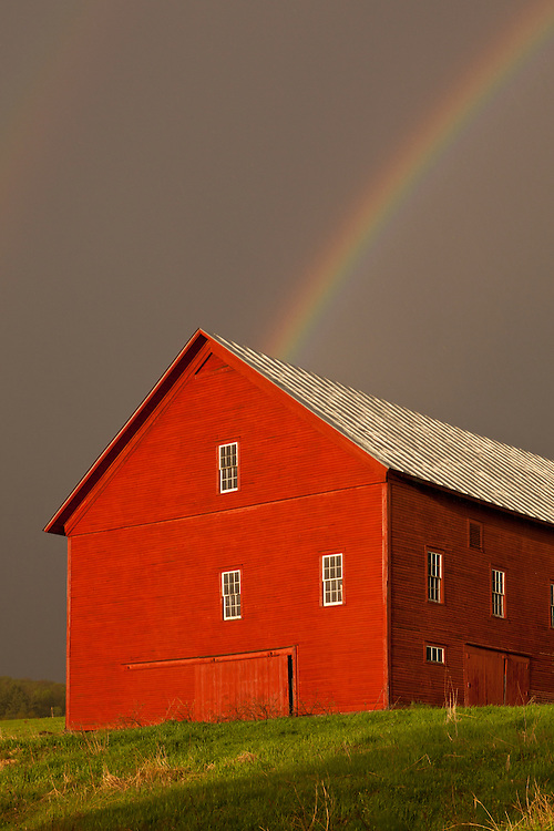 Rainbow over red barn in East Montpelier, Vermont
