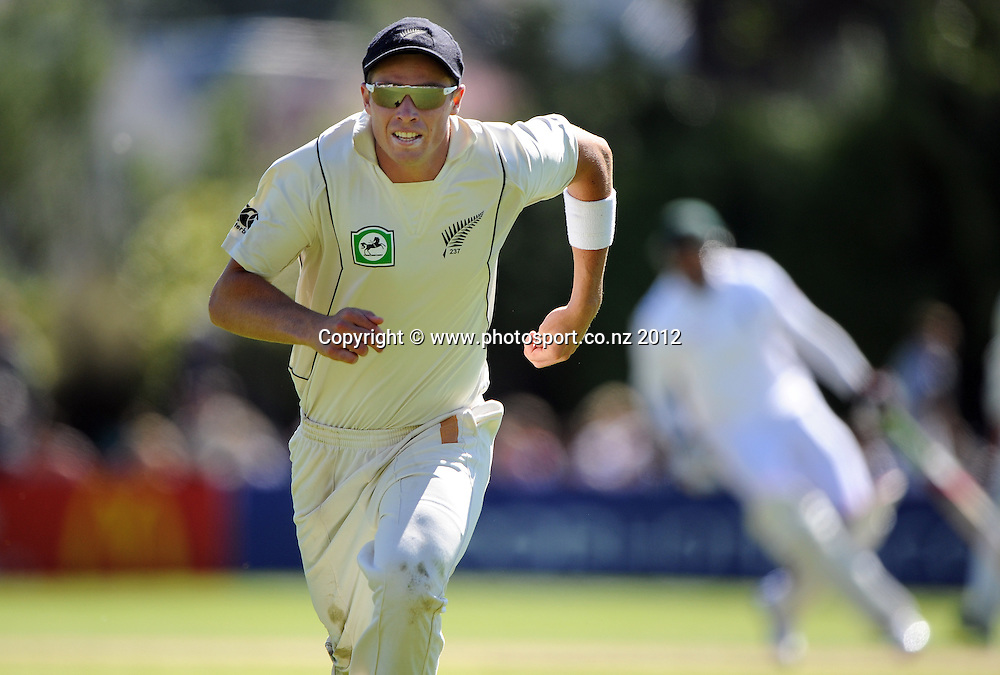 Tim Southee chases the ball to the boundary on Day 3 of the first test match between South Africa and New Zealand at the University Oval in Dunedin, New Zealand on Friday 9 March 2012. Photo: Andrew Cornaga/Photosport.co.nz