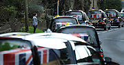© Licensed to London News Pictures. 20/03/2012. Brize Norton, UK. A young girls stands and watches the coffins pass. The courtege passes St Britus church built in 1082 in the village of Brize Norton. The repatriation of six soldiers killed in Afghanistan takes place today 20th March 2012. Sergeant Nigel Coupe, 33, of 1st Battalion The Duke of Lancaster's Regiment, Corporal Jake Hartley, 20, Private Anthony Frampton, 20, Private Christopher Kershaw, 19, Private Daniel Wade, 20, and Private Daniel Wilford, 21, all of 3rd Battalion, the Yorkshire Regiment, were killed in Afghanistan on March 6. Photo credit : Stephen SImpson/LNP