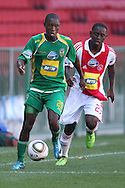 CAPE TOWN, SOUTH AFRICA - 28 MARCH 2010, Njabulo Manqana of Golden Arrows attepmts to get away from Diphetogo Dipsy Selolwane  from Ajax Cape Town's challenge during the Telkom Knock Out match between Ajax Cape Town and Golden Arrows held at Newlands Stadium in Cape Town, South Africa..Photo by: Shaun Roy/Sportzpics