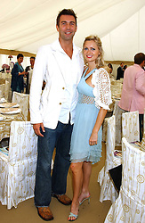 ANOUSKA DE GEORGIOU and DAVID FISHER at the 2005 Cartier International Polo between England & Australia held at Guards Polo Club, Smith's Lawn, Windsor Great Park, Berkshire on 24th July 2005.<br /><br />NON EXCLUSIVE - WORLD RIGHTS