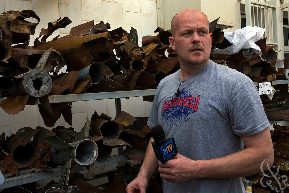 "Samuel J. Wurzelbacher, better known as ""Joe the Plumber""does a report in front of the wrecked remains of rockets which have struck the city of Sderot over the last 8 years January 11, 2009 in Sderot, Israel. Wurzelbacher, who rose to fame during the 2008 election after questioning then presidential candidate Barack Obama about his tax plan, is in the region for about 10 days  to report for the conservative web site Pajamas TV (www.pjtv.com.)"