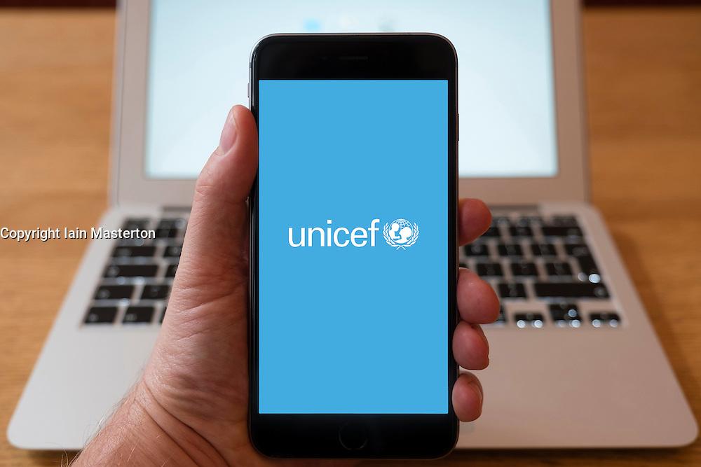 Using iPhone smart phone to display website logo of UNICEF