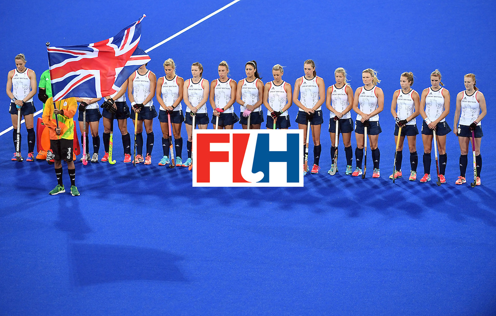 Britain's players line up before the women's quarterfinal field hockey Britain vs Spain match of the Rio 2016 Olympics Games at the Olympic Hockey Centre in Rio de Janeiro on August 15, 2016. / AFP / Pascal GUYOT        (Photo credit should read PASCAL GUYOT/AFP/Getty Images)