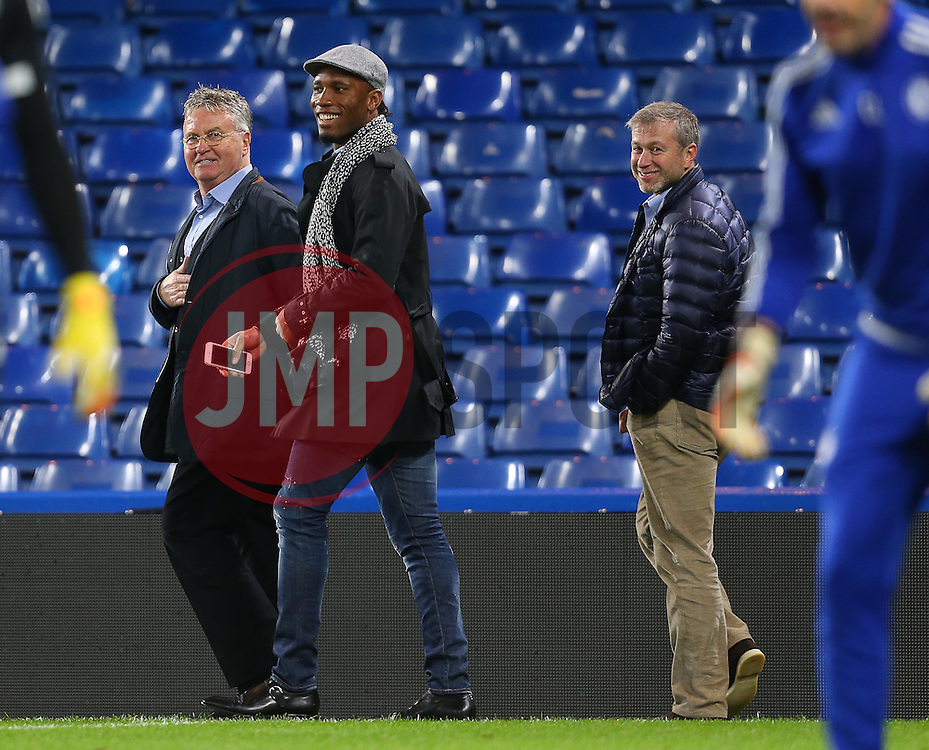 Newly appointed Chelsea Manager, Guus Hiddink ( L ), Didier Drogba ( C ), and Chelsea owner, Roman Abramovich - Mandatory byline: Paul Terry/JMP - 07966 386802 - 19/12/2015 - FOOTBALL - Stamford Bridge - London, England - Chelsea v Sunderland - Barclays Premier League