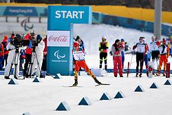 WANG Chenyang CHN LW5/7 competing in the ParaSkiDeFond, Para Nordic Skiing, 20km at  the PyeongChang2018 Winter Paralympic Games, South Korea.