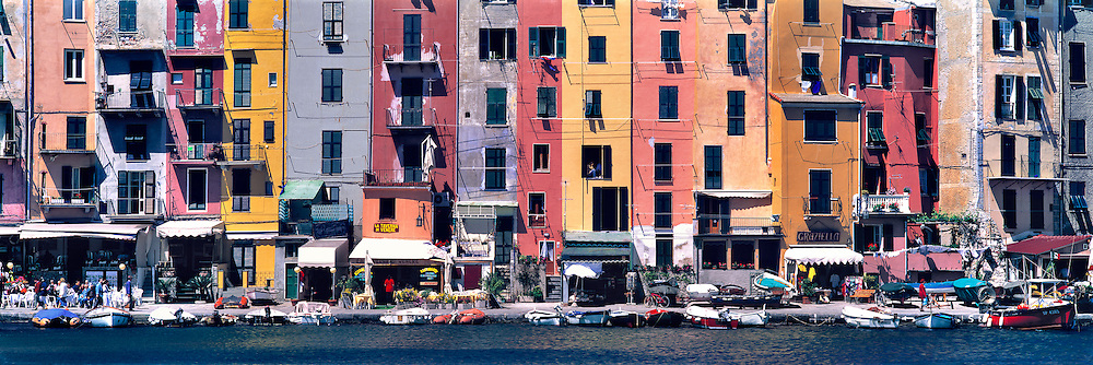 The brightly colored buildings lining the waterfront of Portovenere, on Italy's Ligurian coast, create a striking mosaic when compressed by a telephoto perspective from a distant jetty.
