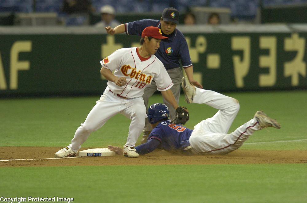 Team Chinese Taipei Chin-Lung Hu steals third base in the 2nd inning against Team China in Game 5 of the World Baseball Classic at Tokyo Dome, Tokyo, Japan.