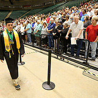 Members of the Mooreville High School graduating class of 2019 enter the BancorpSouth Arena for their graduation ceremony on Saturday.