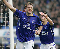 Photo: Dave Howarth.<br /> Everton v Charlton Athletic. The Barclays Premiership.<br /> 02/01/2005.  Everton's goal scorer James Beattie is congratulated by team mate Leon Osman