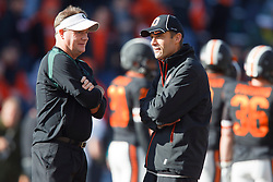 December 4, 2010; Corvallis, OR, USA;  Oregon Ducks head coach Chip Kelly (left) meets with Oregon State Beavers head coach MIke Riley (right) before the game at Reser Stadium.