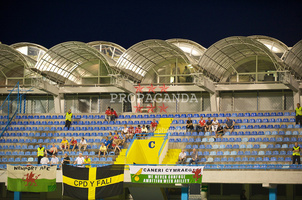 PODGORICA, MONTENEGRO - Wednesday, August 12, 2009: Wales supporters with a Newport AFC flag during an international friendly match against Montenegro at the Gradski Stadion. (Photo by David Rawcliffe/Propaganda)