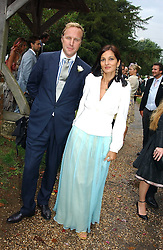 SIMON & YASMIN MILLS at the wedding of Tom Parker Bowles to Sara Buys at St.Nicholas Church, Rotherfield Greys, Oxfordshire on 10th September 2005.<br /><br />NON EXCLUSIVE - WORLD RIGHTS