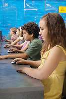 School children using computers in classroom
