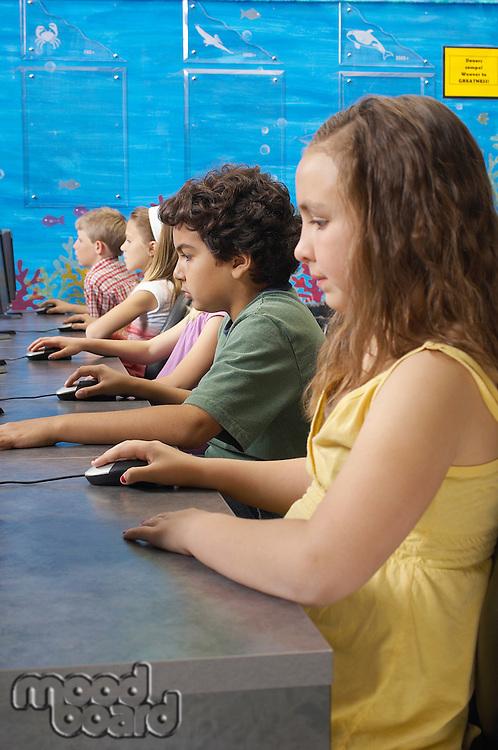 School children using computers in classroom
