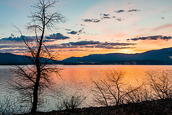 """Stampede Reservoir Sunrise 1"" - Photograph of an orange colored sunrise at Stampede Reservoir."
