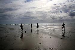 NEW ZEALAND PIHA BEACH 12DEC07 - Boys play football on Piha Beach, West Coast of northern Island, New Zealand.<br /><br />jre/Photo by Jiri Rezac<br /> <br /> <br />© Jiri Rezac 2007