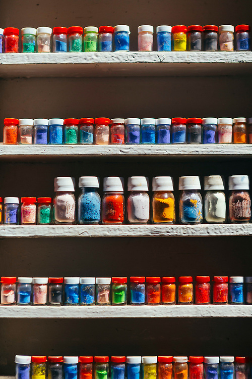 Assorted natural powdered paints and pigments for sale in Rahba Kedima - the spice square, Marrakech Medina, Southern Morocco, 2018–03-31.