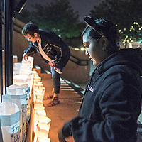 Alina Herrera, 16, on Team Bengals reads Luminaria's lined up at Relay for Life Friday, June 21 at McKinley County Courthouse Square in Gallup. Herrera lost her father to colon cancer two years ago.