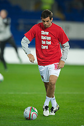 CARDIFF, WALES - Friday, October 8, 2010: Wales' Joe Ledley wears a 'Show Racism The Red Card' shirts before the UEFA Euro 2012 Qualifying Group G match against Bulgaria at the Cardiff City Stadium. (Pic by David Rawcliffe/Propaganda)