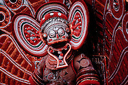 Theyyam is the ancient hindu ritual of North Malabar in Kerala in which empowered men after suitable preparations become deities. It's the living cult with several thousand-year-old traditions and a socio-religious ceremony which attributes great importance to the worship of heroes and ancestral spirits. <br />