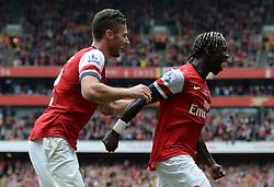 Arsenal's Oliver Giroud and Arsenal's Barcay Sagna celebrate a goal - Photo mandatory by-line: Mitchell Gunn/JMP - Tel: Mobile: 07966 386802 22/09/2013 - SPORT - FOOTBALL - Emirates Stadium - London - Arsenal V Stoke City - Barclays Premier League