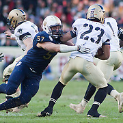 Navy Linebacker Caleb King #57 attempts to tackle Army Running Back Malcolm Brown #23 in the second quarter of the 112th version Of this storied rivalry Saturday, Dec. 10, 2011 at Fed EX field in Landover Md. ..Navy set the tone early in the game as Navy defeats Army 31-17 in front of 82,000 at Fed EX Field in Landover Md