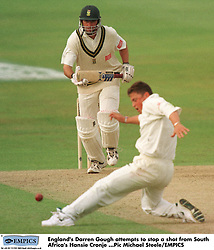 England's Darren Gough (right) attempts to stop a straight drive from South Africa's Hansie Cronje (left)