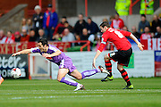Plymouth Argyle's Carl McHugh is fouled by Exeter City's Matt Oakley during the Sky Bet League 2 match between Exeter City and Plymouth Argyle at St James' Park, Exeter, England on 2 April 2016. Photo by Graham Hunt.