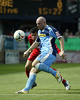 Photo: Marc Atkins.<br /> Rushden & Diamonds v Wycombe Wanderers. Coca Cola League 2. 22/04/2006. Tommy Mooney of Wycombe fends off the Rushden defence.