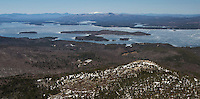 Lakes Biplane takes flight over Mount Major with Rattlesnake Island on Lake Winnipesaukee in the distance on Thursday afternoon.  (Karen Bobotas Photographer)