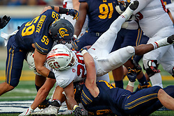 BERKELEY, CA - DECEMBER 01: Linebacker Jordan Kunaszyk #59 of the California Golden Bears strips the football from running back Bryce Love #20 of the Stanford Cardinal during the fourth quarter at California Memorial Stadium on December 1, 2018 in Berkeley, California. The Stanford Cardinal defeated the California Golden Bears 23-13. (Photo by Jason O. Watson/Getty Images) *** Local Caption *** Jordan Kunaszyk; Bryce Love