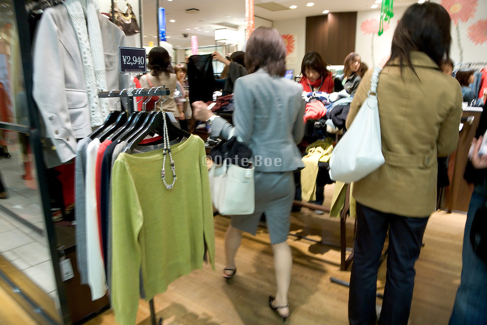 women shopping at a clothing boutique Japan Tokyo
