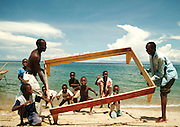 Africa. Malawi. Family moving house by boat up the Lake shore. All furniture carried on small motor boat. .CD0010