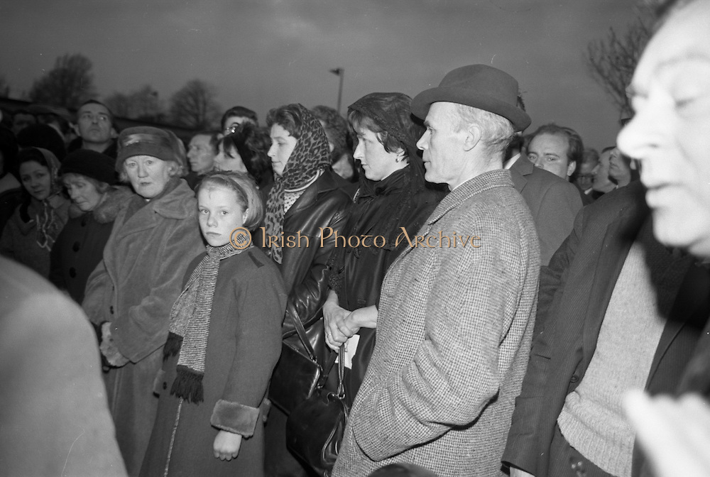 Mrs. Beatrice Behan, wife of the dead playright, waits outside the Church of the Sacred Heart. Donnybrook, as the remains of her late husband, Brendan, are carried into the church.  Beside her is her sister, Celia Salkeld, a noted actress..21.03.1964